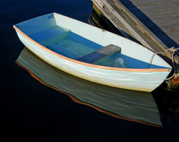 Light Blue Dinghy: A light blue dinghy shot at sunset in Belfast Maine