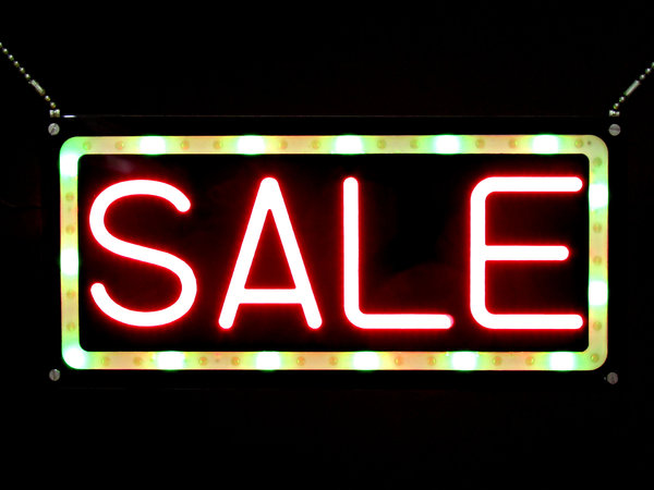 lit-up for bargains: bright 'neon'/LCD lit sale sign