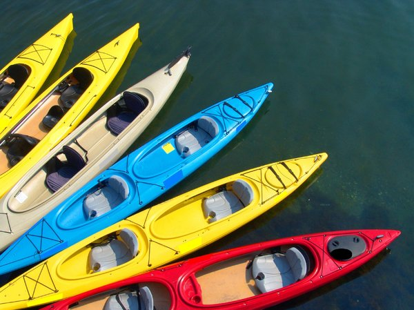 Kayaks ready for their riders: Colorful Kayaks waiting for their riders