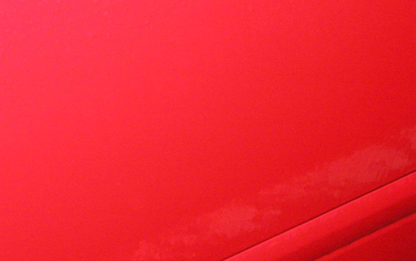 reflections from shiny cars: a red car door