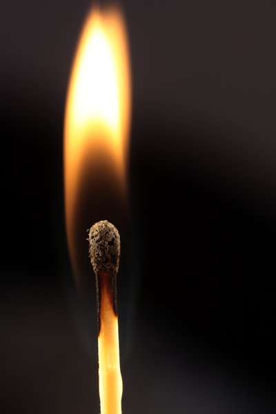 Lighting a match in