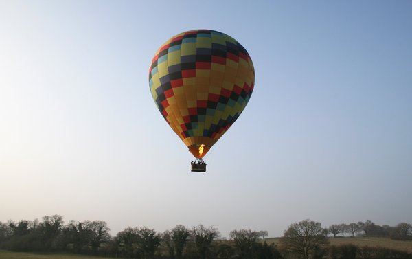 Hot air balloon: Launching a hot air balloon in early evening in England in spring.