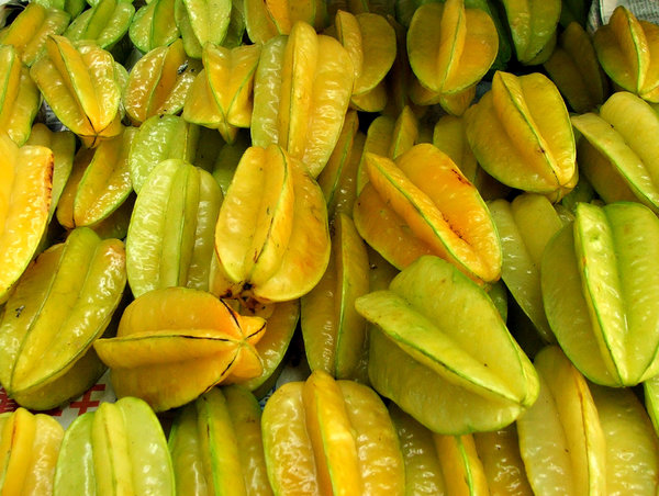 starfruit: bulk quantities of fresh starfruit ready for purchase at the market