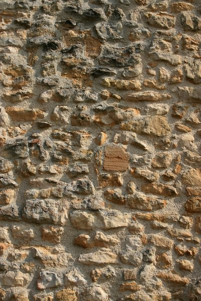 Old wall texture: An old wall of weathered flint and sandstone.