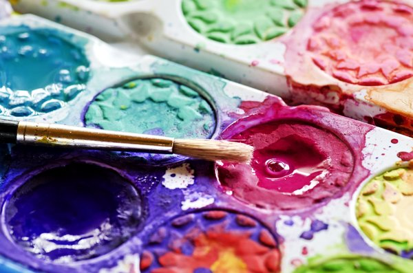 Paint colors: watercolor paint palette and brush