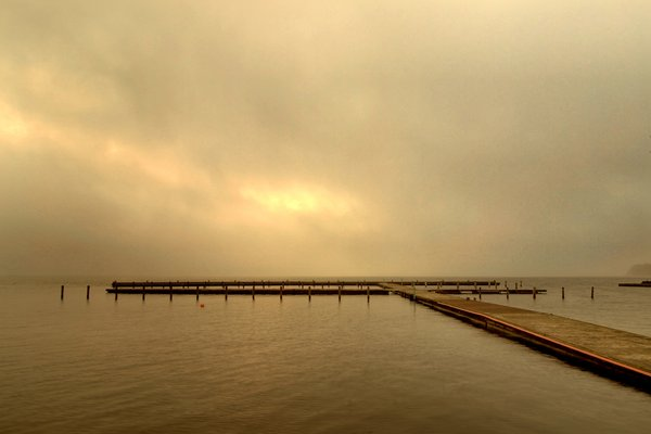 Misty morning - HDR: Misty moring at the lake with empty boardwalks - no boat are in the water yet. The picture is HDR.