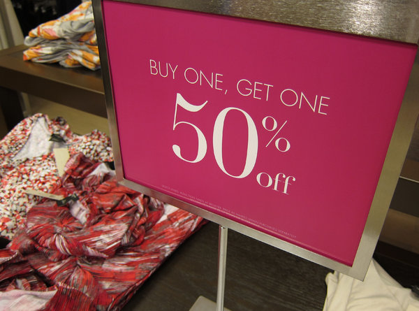 Sale Sign: A sale sign in a clothing store.