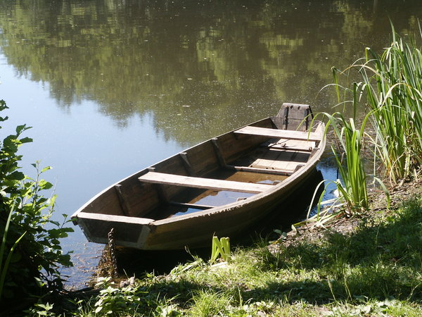 Boat on the lake: Wooden boat on the lake