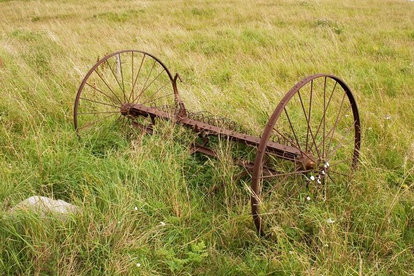 Old harrow: An old neglected harrow in a field in Denmark.