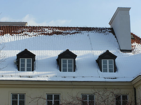Superb Snow On The Roof: A Snow On The Roof Of A Building. With Dormer