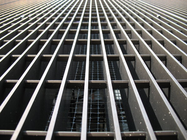 steel grille: steel grille covering a mechanical pit.