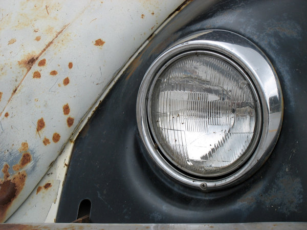 headlamp: headlamp of a rusty old beetle.