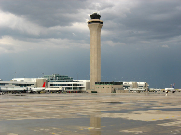 control tower: a traffic control tower at denver international airport.