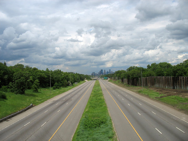 empty highway: an empty highway, leading to a city in the distance.  35W north into minneapolis was closed for construction work at the diamond lake bridge.