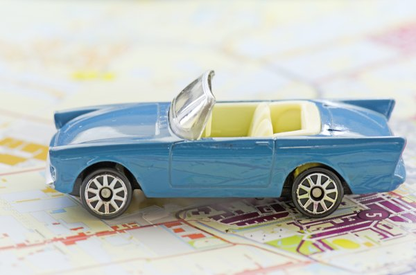 Car on map: Toy car on road map