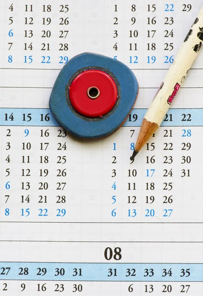 Pencil on calendar: pencil and eraser on calendar