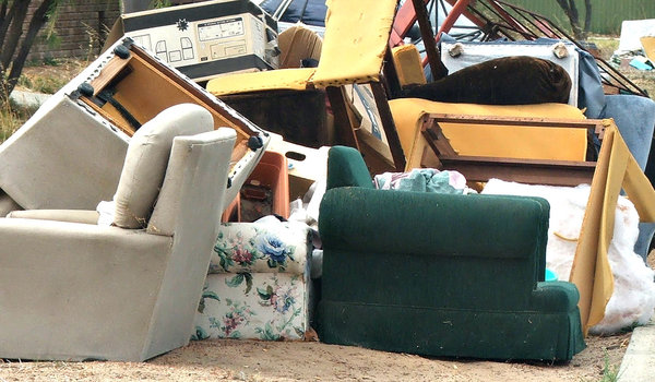 no longer wanted: unwanted furniture and household goods dumped for roadside collection