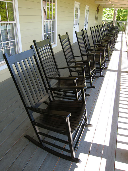 Rocking Chairs: Rocking chairs on a porch.