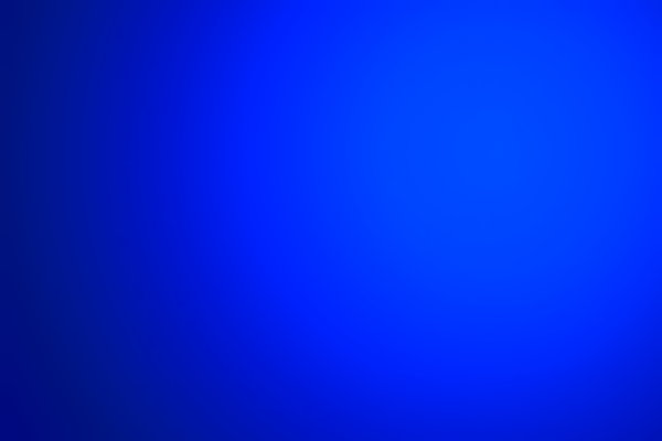 Light Effect Blue: A blue gradient background with a spot light effect.