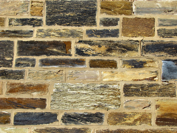 stone patchwork1: historic wall made up of patchwork of stone surfaces & types