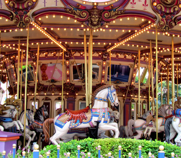 at the carousel: a carnival's children's horse carousel - merry-go-round