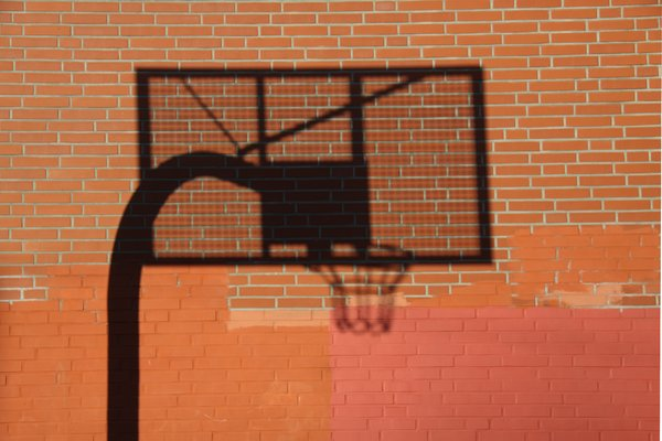 Shadowy Basketball Board: Shadow  of a basketball board on the wall