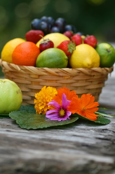 Fruit Basket: Stil life of fresh fruit and flowers.