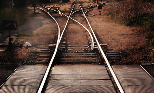 Railroad tracks: Railroad track that spins off into several branches - a good symbol for a choice among several possibilities, several ways