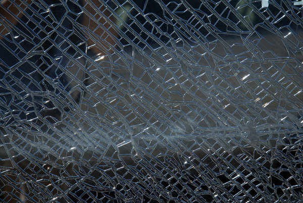 Cracked Glass: A cracked glass window.