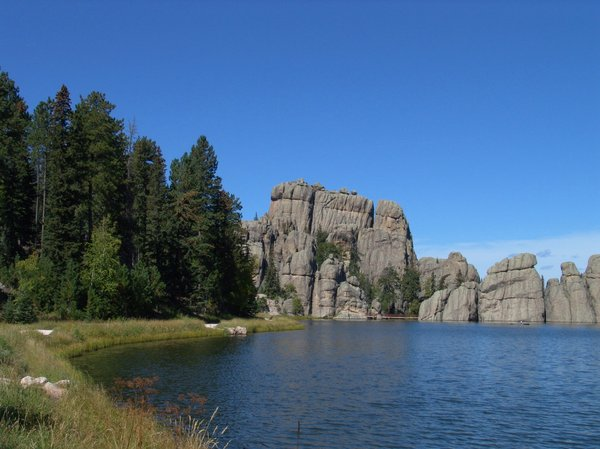 Sylvan Lake, Black Hills, Sout: Sylvan Lake, Black Hills, South Dakota is a high elevation lake, clear and clean with Rainbow Trout. A fishing persons dream with a walkway and foot bridge around the large granite bolders and pine forest and lake.