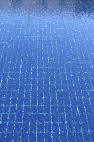 Swimming pool ripples: Ripples on a large outdoor swimming pool.