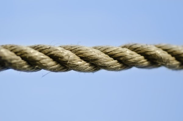 Rope in the sky: Piece of rope against blue sky