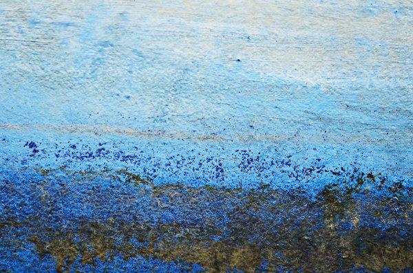 Blue painted texture: Grungy old boat paint close-up