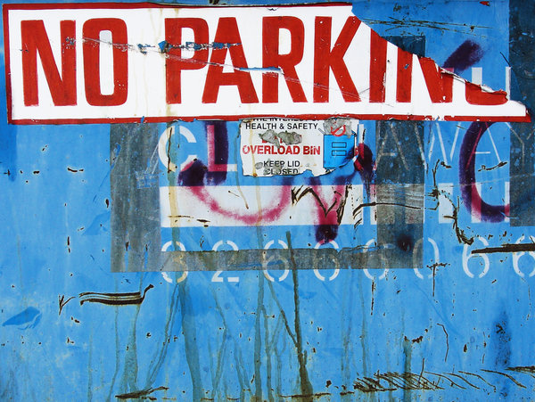 grunge sign: grungy urban sign with graffiti and stickers peeling off