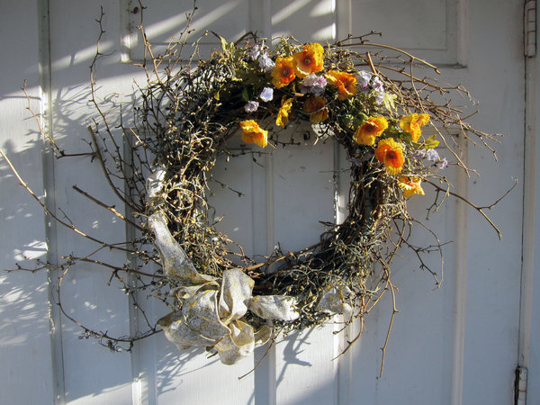 Wreath: A wreath on a door.