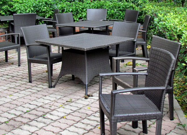 dark dining outdoors: black caneware outdoors dining setting