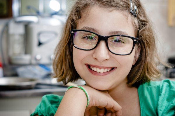 Smart Girl: A young and pretty smart girl with her glasses