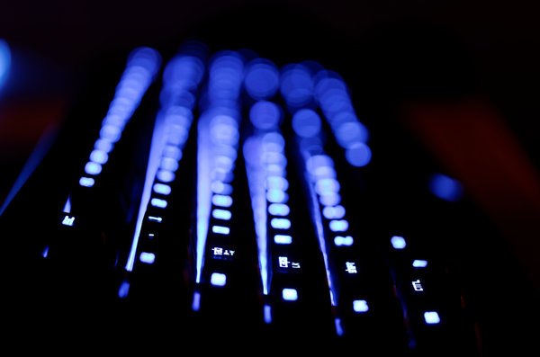 backlight keyboard: glowing keyboard in the dark, very shallow DOF