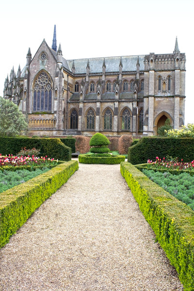 Formal gardens: Formal gardens by a church in England.