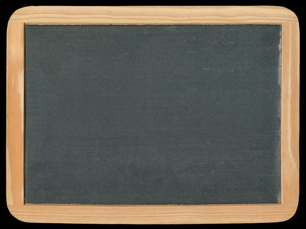 Vintage Chalkboard: Blank vintage chalkboard isolated on a black background.