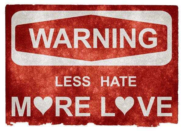 Grunge Warning Sign: Grunge textured warning sign on vintage paper, with the words LESS HATE MORE LOVE. A conceptual design with more visual emphasis on the love aspect.