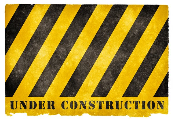 Under Construction Grunge Sign: Grunge textured UNDER CONSTRUCTION sign on vintage paper.