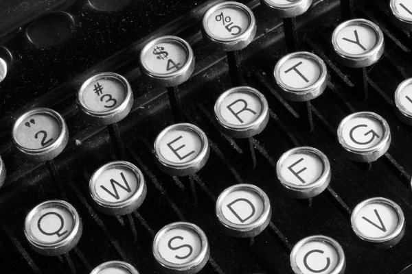 Antique Typewriter Close-up: Close-up of an antique qwerty-format typewriter converted in black & white for a more vintage look.