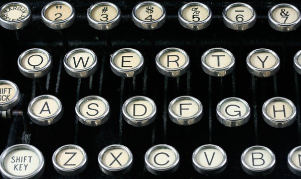Antique Typewriter Close-up: Close-up of an antique qwerty-format typewriter.