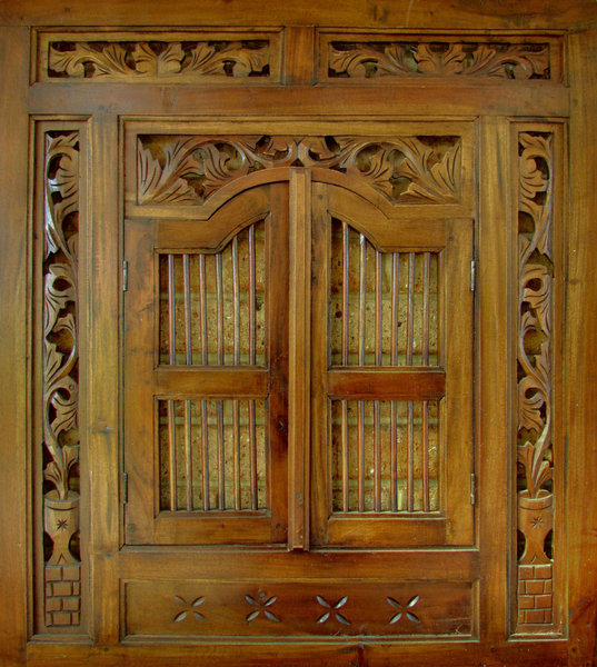 carved frame1: decorative carved wooden frame with doors