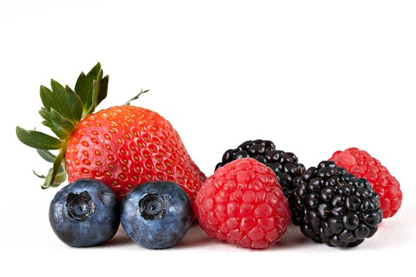 Berry Mix: Mix of strawberry, blueberries, raspberries, and blackberries isolated on a white background.