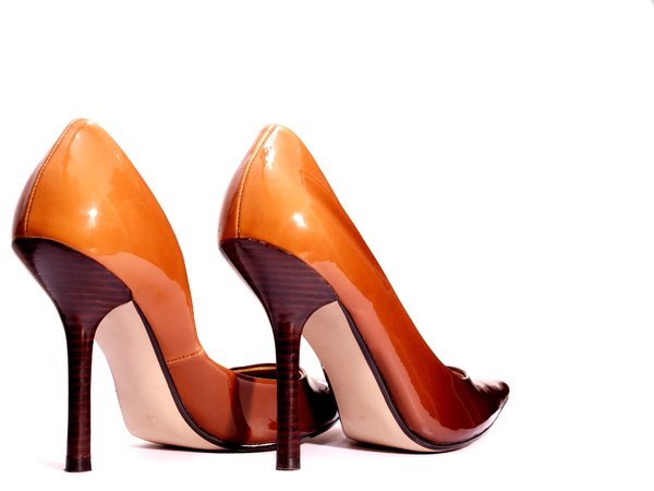 High heel shoes: Pair of high heel womens shoes. Gradient brown from toe to heel.