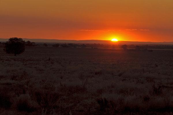 sunset: sun setting over hills