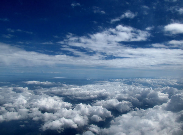 above and below2: clouds seen through plane window during flight
