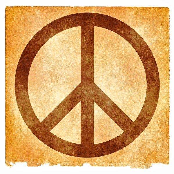 Peace Grunge Sign: Grunge textured peace symbol on vintage paper, with sepia toning for a more aged feel.